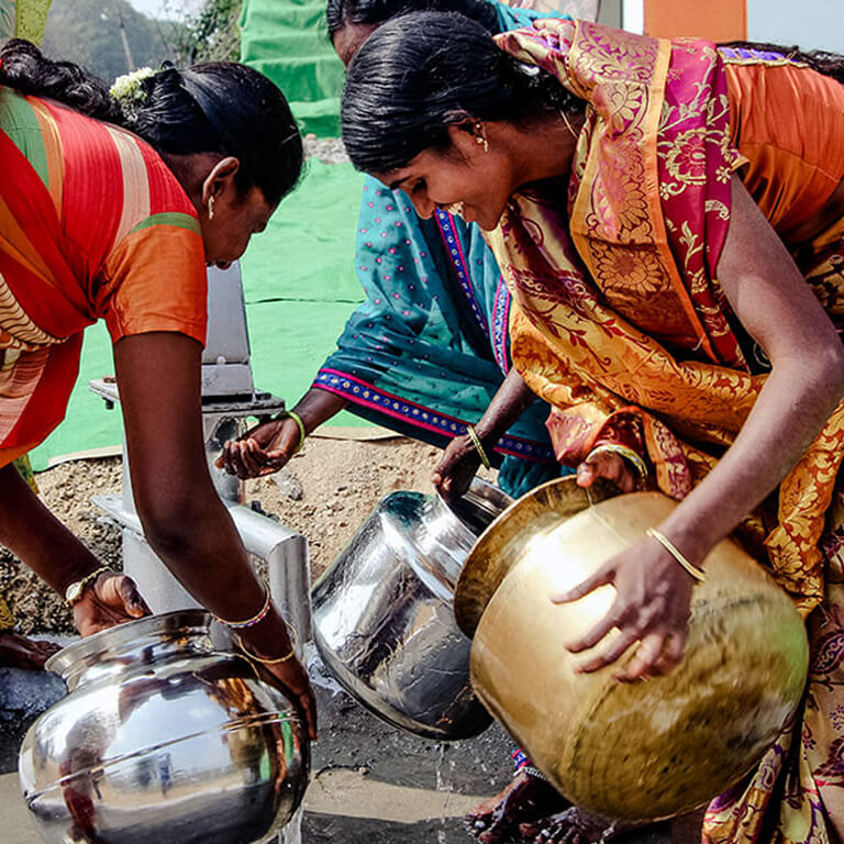 Women Pouring Water