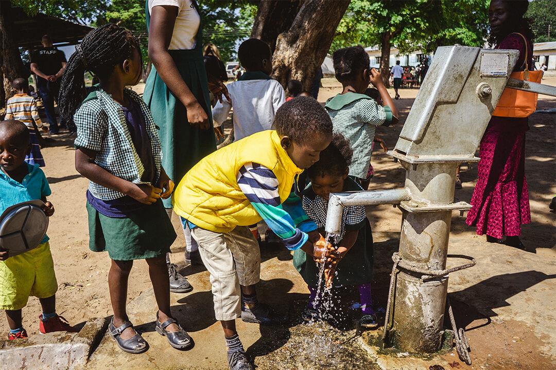 Boy washing his hands.